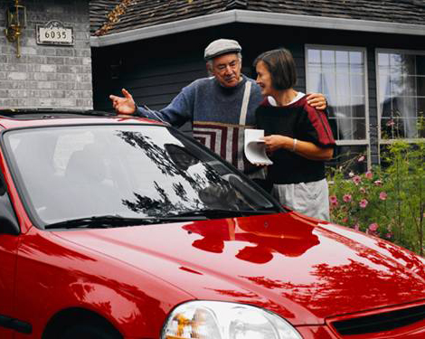 photo of couple with red car